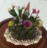 Gnome figurine in a garden floral